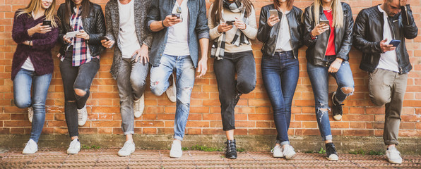 Group of teenagers with smartphone outdoor