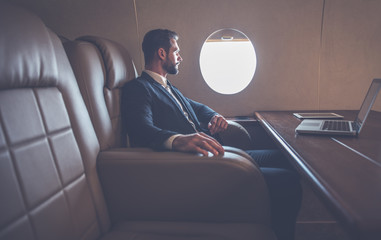 Businessman flying on his private jet Fototapete