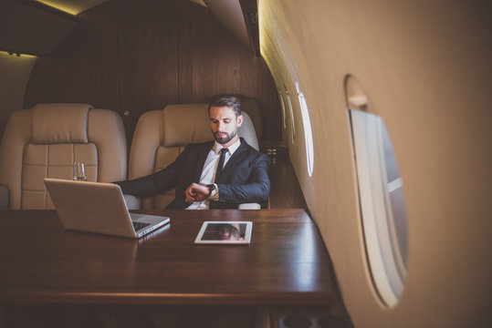 Businessman flying on his private jet