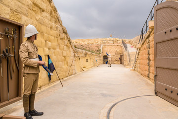 Photo sur Aluminium Fortification Kalkara, Malta. The show at Fort Rinella (1879-1884). Soldiers of the Victorian era show signal transmission