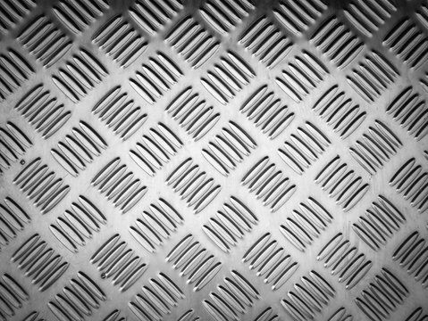 grungy texture background of weathered metal diamond plate