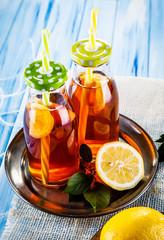 Lemons with lemonade on wooden table