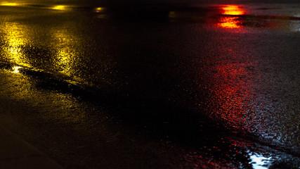 Background of wet asphalt with neon light. Blurred background, night lights, reflection.