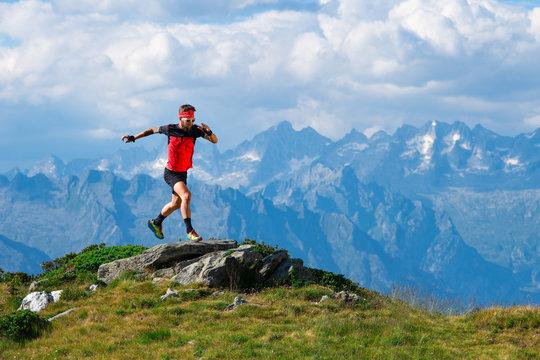 Skyrunning athlete in training on mountain ridges