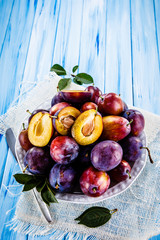 Plums on wooden table