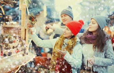 positive family of three at Christmas market