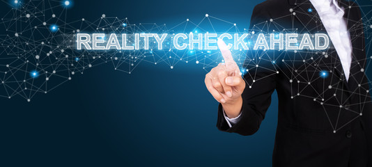 Reality Check Ahead concept with Hand of business pressing a button Reality Check Ahead