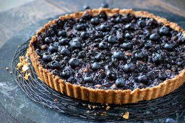 baked blueberry tart flutted crust edge closeup