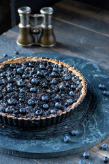 baked blueberry tart in pan closeup