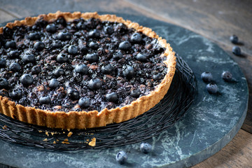 baked blueberry tart flutted crust edge closeup