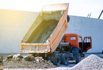 Construction truck cement transport road build building sun blue sky