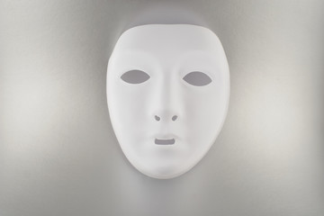 Plastic white face mask stock images. White mask on silver background. Plastic human mask