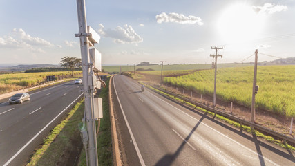 Traffic radar with speed enforcement camera in a highway. Automatic number plate recognition used for the detection of average speeds
