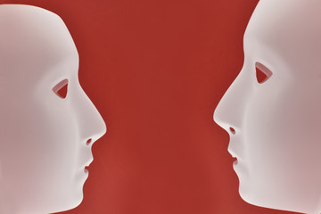 Plastic human face stock images. Plastic white face mask stock images. White mask on a red background. Two plastic human mask