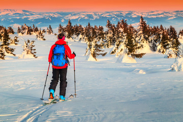 Ski touring in the mountains at sunset, Transylvania, Romania, Europe