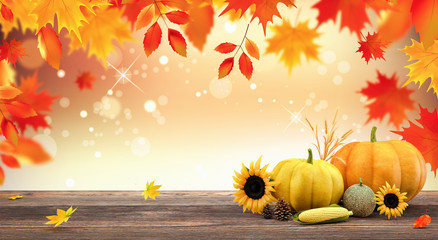 Autumn seasonal background with red falling leaves and fall decorations on wooden plank