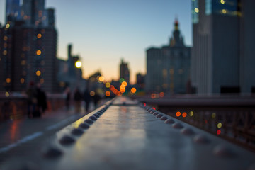 blurred Night lights of the New York with metal part of bridge foreground Fotomurales