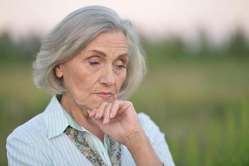 Portrait of a cute sad senior woman