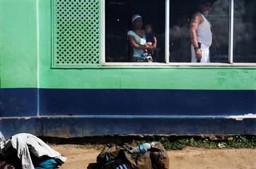 Venezuelan people are pictured at bus terminal in Santa Elena