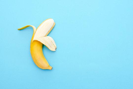 Yellow ripe banana peeled half