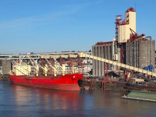 Grain elevetors and cargo ship.