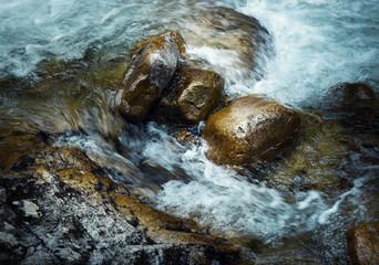 three stones in the wild river