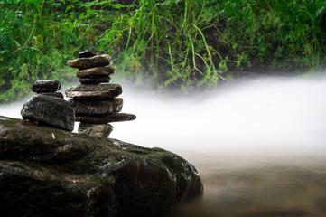 ZEN BALANCING ROCKS NEAR RIVER