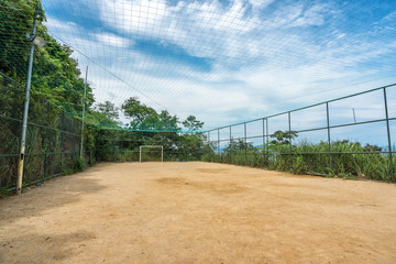 Empty soccer field on the top of the mountain with mesh grid, Brazil
