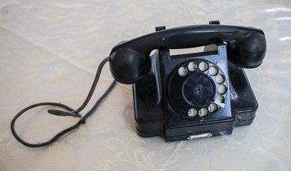Retro black telephone on a table