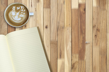 Hot coffee art and empty book on wooden table, copy space, for presentation and template
