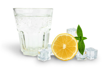 Deurstickers Opspattend water glass of soda next to ice, mint and orange, ingredients for lemonade