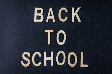 Back to school concept over classroom blackboard background