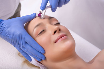 Close up of beautiful woman in beauty salon during mesotherapy procedure