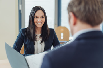 Attentive smiling young woman in a job interview