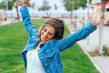 Happy relaxed young woman stretching her arms