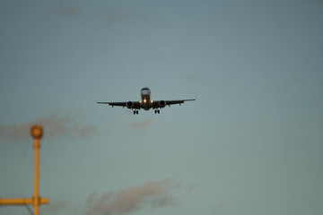 City Airport plane landing in the evening with tourists