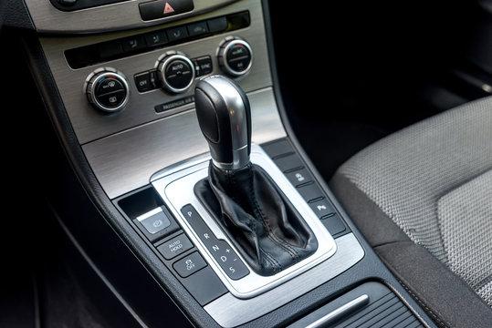 Closeup of automatic transmission inside car salon