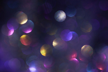 dark background. shiny spots. lens flare. blurred defocused bright light.colorful abstract blur bokeh light.