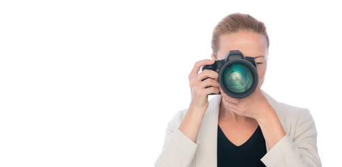 Female photographer taking images with dslr camera isolated on white background.