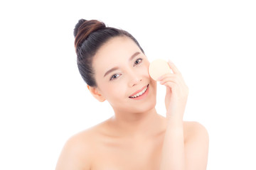 Portrait of beautiful asian woman applying powder puff at cheek makeup of cosmetic, beauty of girl with face smile isolated on white background, wellness and healthcare concept.