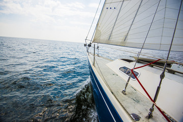 Pure morning light over he Baltic sea. A view from the sailboat's deck to the bow, Estonia
