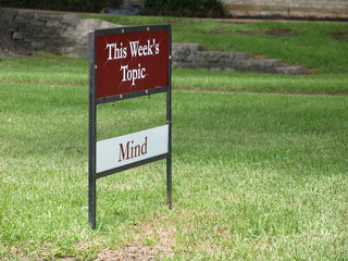 An old fashioned real estate yard sign is used to display weekly topics at a local religious organization.