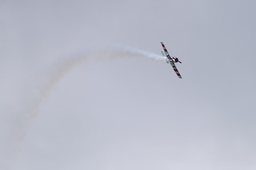 Foto op Aluminium Luchtsport Yak-52 aircraft in the sky performs the program at the air show