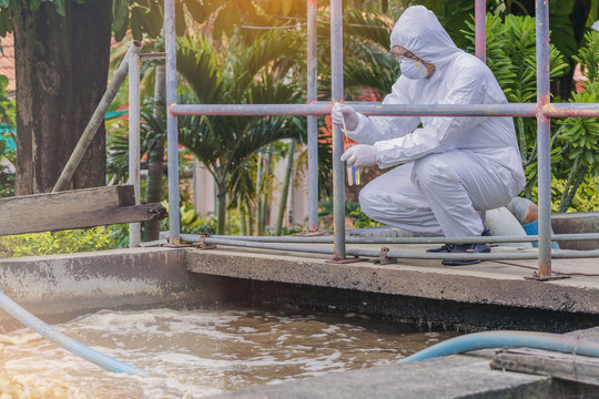 Scientist experimenting with water quality at wastewater treatment system.