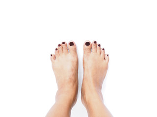 Selfie woman feet on white background.