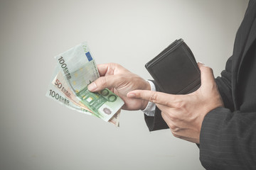 Business man holding bank notes out wallet.