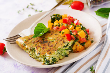 Frittata with zucchini, cheese, basil and salsa from tomatoes. Useful breakfast. Italian omelette.