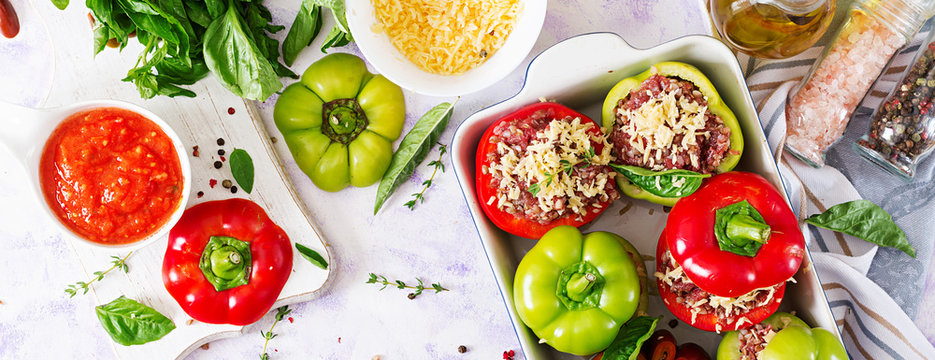 Ingredients for preparation of stuffed pepper with minced meat and buckwheat porridge. Tasty food. Flat lay. Top view. Banner