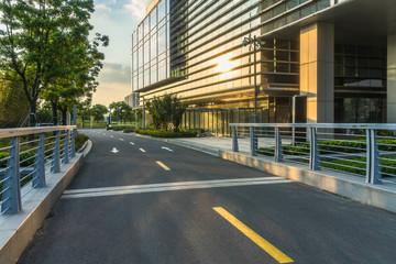 Empty urban road near modern office buildings