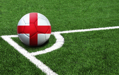 soccer ball on a green field, flag of England